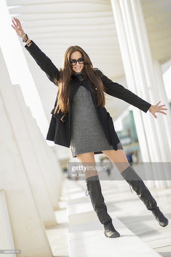 Young woman, wearing casual clothes, with long hair : Stock Photo