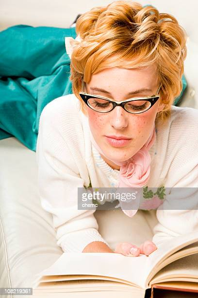 Young Woman Wearing Cat Eye Glasses and Reading