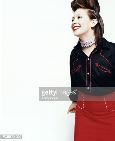 Young woman wearing cowboy shirt and skirt, hair in pompadour : Stock Photo
