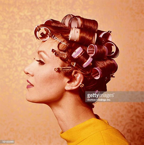 Young woman wearing curlers, profile, 1960's