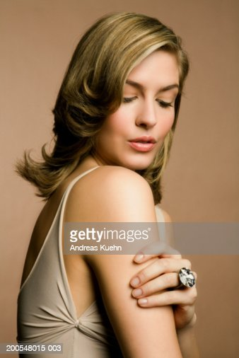 Young woman wearing diamond ring, close-up : Stock Photo