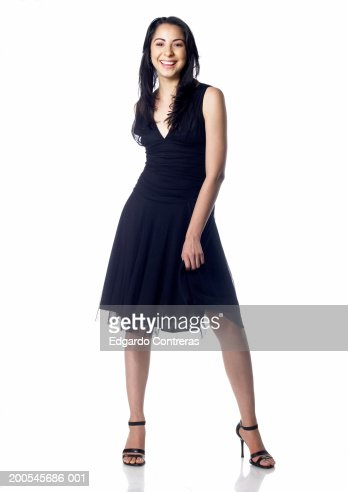 Young Woman Wearing Dress And High Heels Smiling Portrait Stock ...