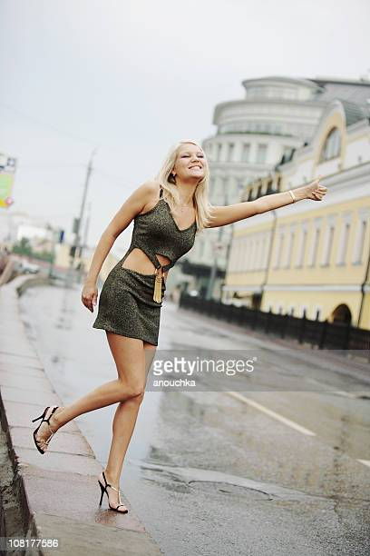 Young Woman Wearing Dress Hitchhiking on Moscow Street