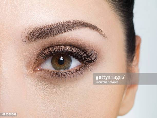 Young woman wearing eye make-up, close-up