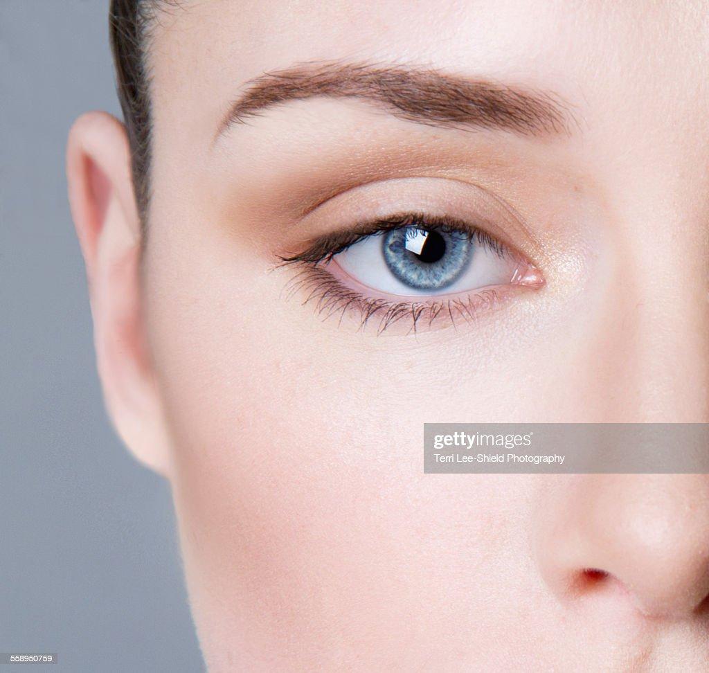 Young woman wearing eye make-up, close-up