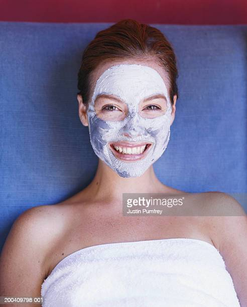 Young woman wearing face mask, smiling, portrait, overhead view