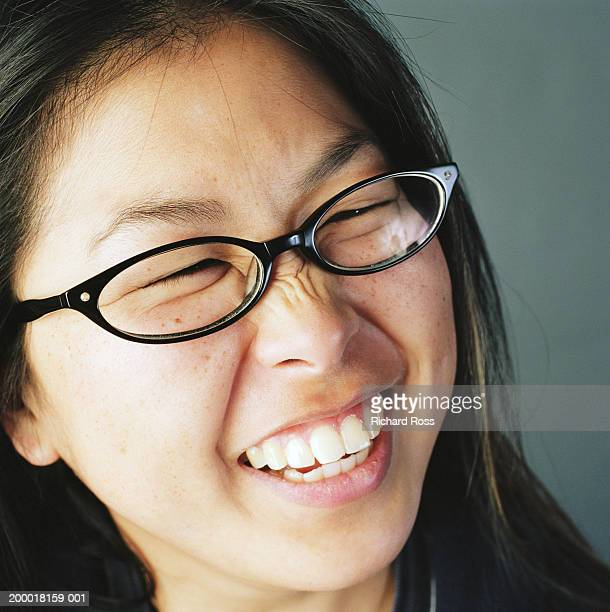 Young woman wearing glasses, laughing