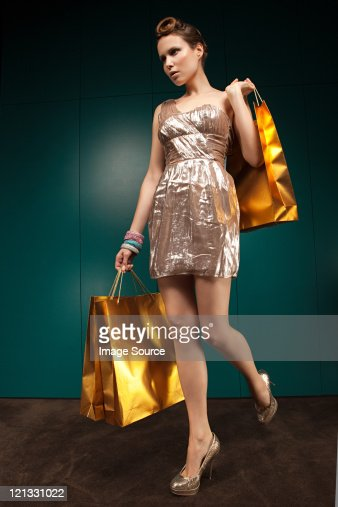 Pretty Lady In A Blue Dress Holding Shopping Bags Stock Photo ...
