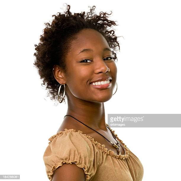 Young woman wearing gold hooped earrings is smiling