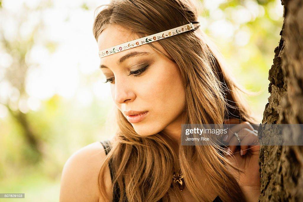 Young woman wearing headband, looking down