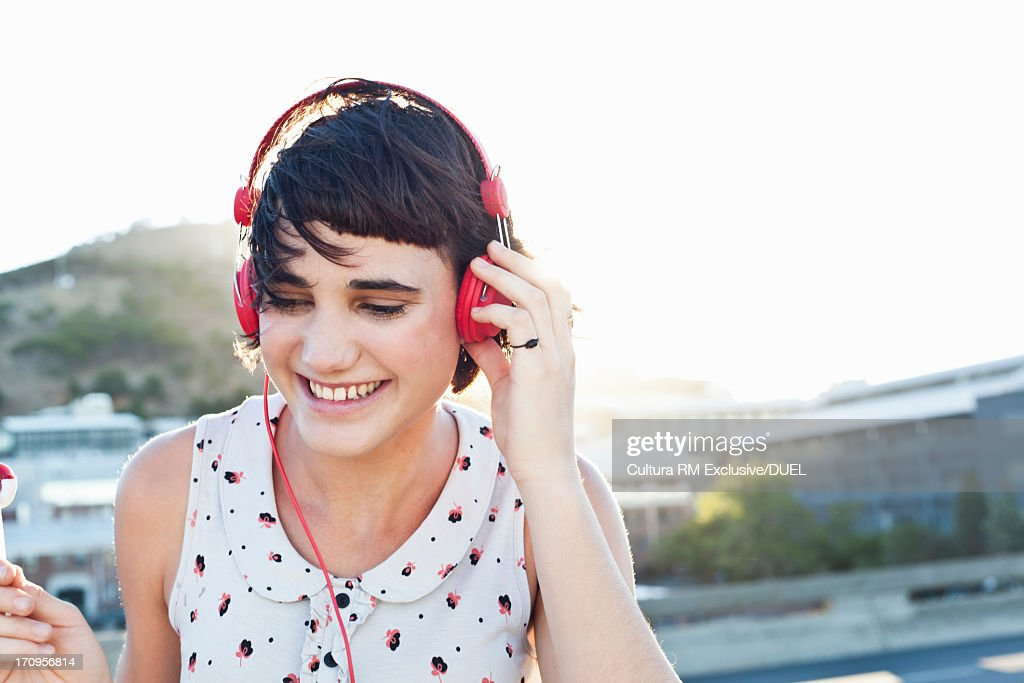 Young woman wearing headphones : Stock Photo