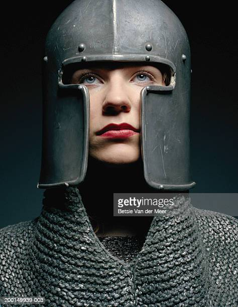 Young woman wearing knight outfit, close up