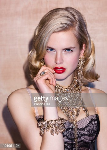 Young woman wearing lingerie and jewelry : Stock Photo