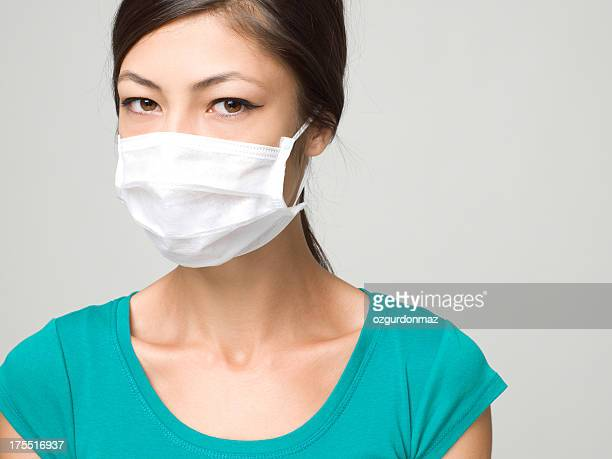 Young Woman Wearing Medical Face Mask