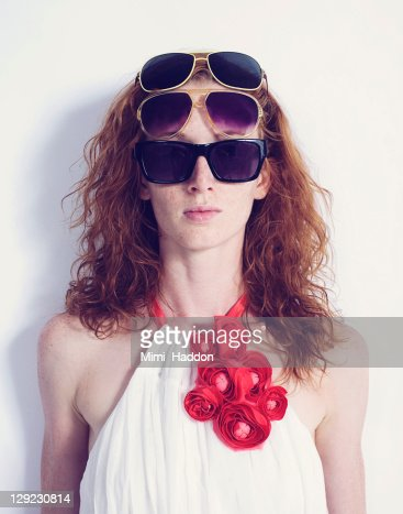 Young Woman Wearing Multiple Pairs of Sunglasses