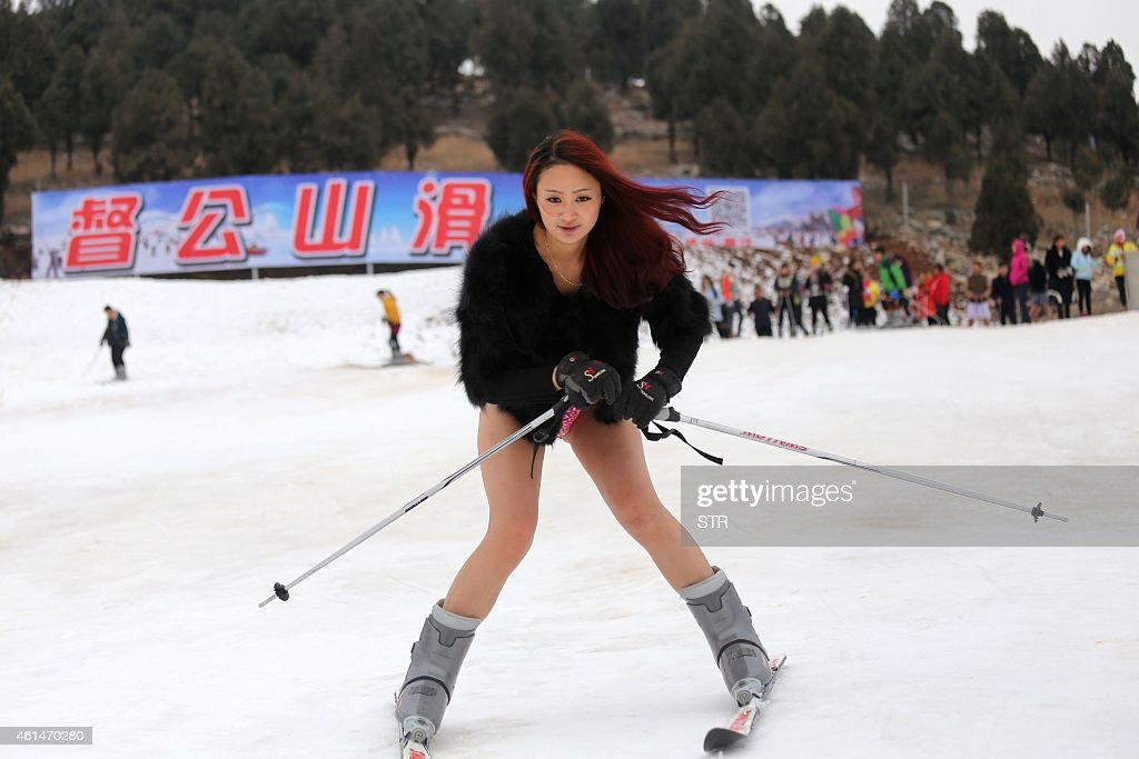 A young woman wearing no trousers hits the ski slopes at a ski resort in Xuzhou in east China's Jiangsu province on January 13 2015 in a promotional...