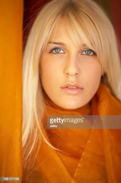 Young Woman Wearing Orange Shawl Scarf