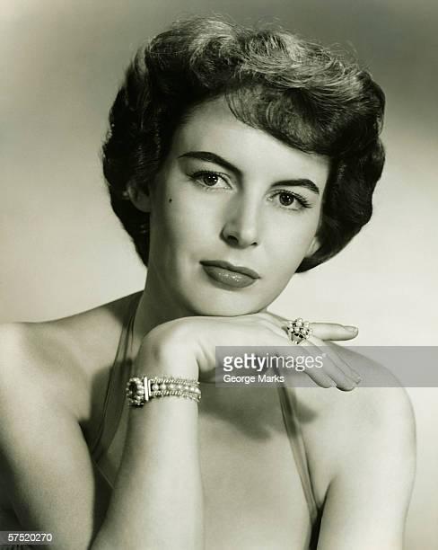 Young woman wearing pearl jewellery, (B&W), portrait