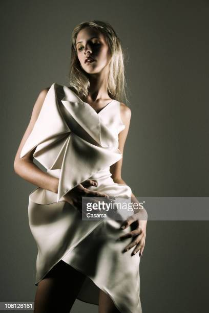 Young Woman Wearing Silk Dress and Posing