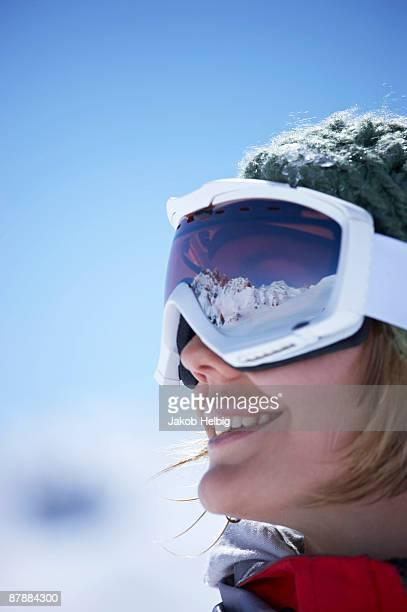 Young woman wearing ski goggles