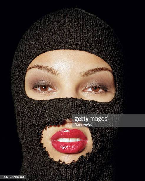 Young woman wearing ski mask, close-up, portrait