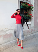 Young beautiful woman wearing skirt and sweater outdoor