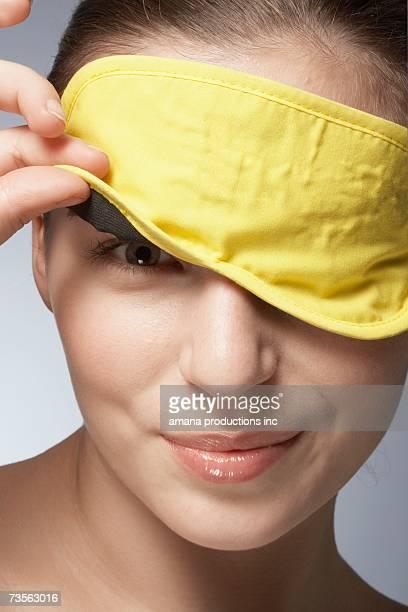 Young woman wearing sleep mask