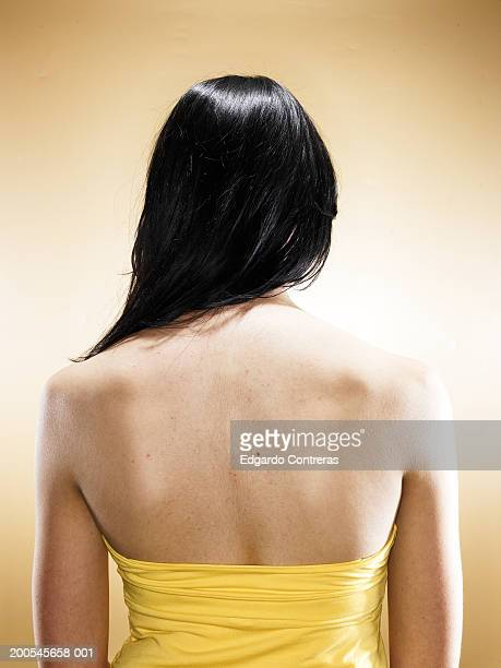 Young woman wearing strapless top, rear view