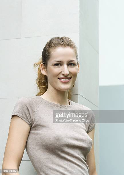 Young woman wearing tee-shirt, smiling, portrait