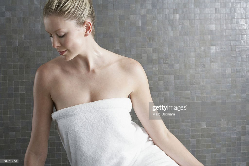 Young woman wearing towel, indoors : Stock Photo