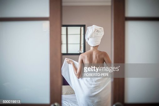 Young woman wearing towel