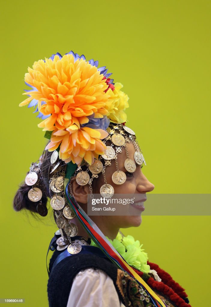 A young woman wearing traditional Serbian folk dress attends the 2013 Gruene Woche agricultural trade fair on January 18, 2013 in Berlin, Germany. The Gruene Woche, which is the world's largest agricultural trade fair, runs from January 18-27, and this year's partner country is Holland.