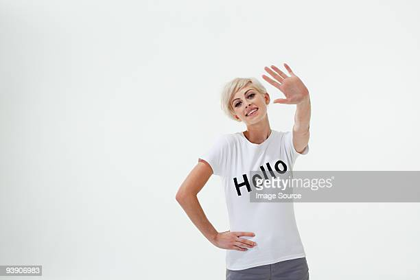Young woman wearing t-shirt that says hello