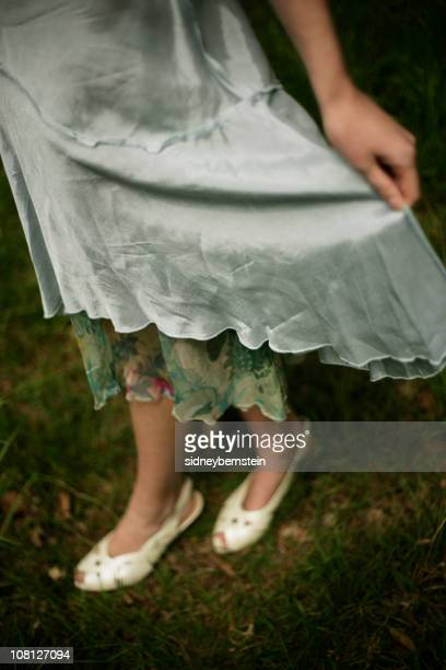 Young Woman Wearing Vintage Dress and Shoes