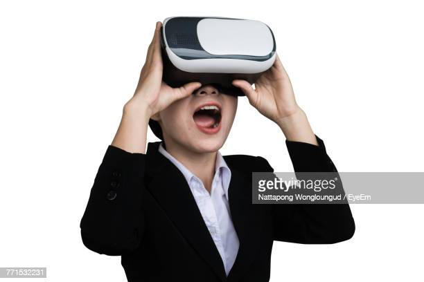 Young Woman Wearing Virtual Reality Simulator Against White Background