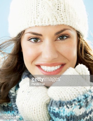 Young woman wearing warm clothing, smiling, portrait : Stock Photo