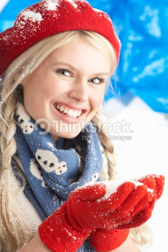 243359854c8de Young Woman Wearing Warm Winter Clothes And Hat Holding Snow In Studio    Stock Photo