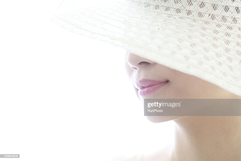 young woman wearing white hat,lip close-up : Stock Photo