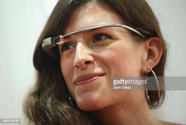 A young woman wears Google Glass at an unrelated book presentation and media event on June 10 2014 in Berlin Germany Google Glass which films what...
