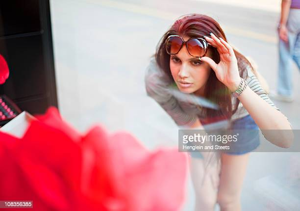 Young woman window shopping