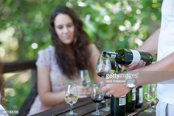 Young woman wine tasting at vineyard
