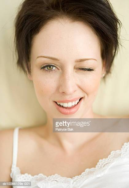 Young woman winking, portrait, close-up