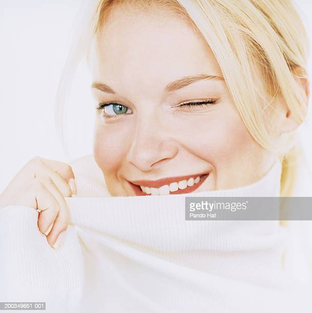 Young woman winking, smiling, portrait, close-up