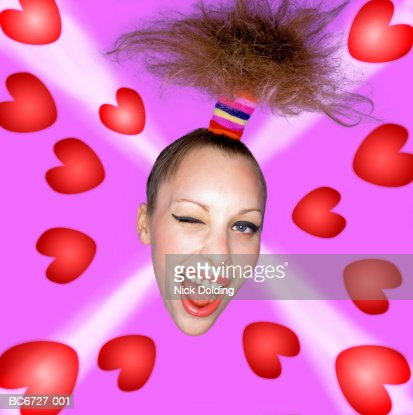 Young woman winking, surrounded by hearts close-up (Enhancement)