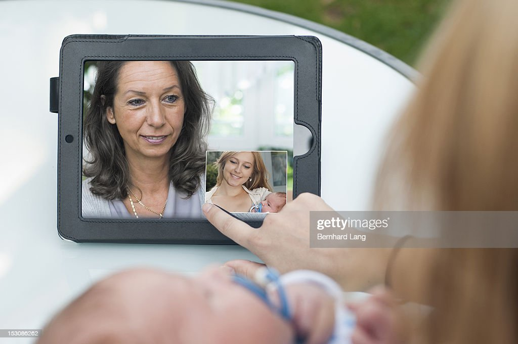 Young Woman wit baby communicating with mother : Stock Photo