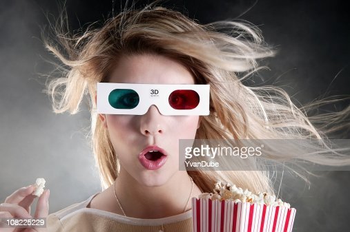 young woman with 3D movie glasses and popcorn