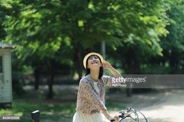 young woman with a bicycle riding face
