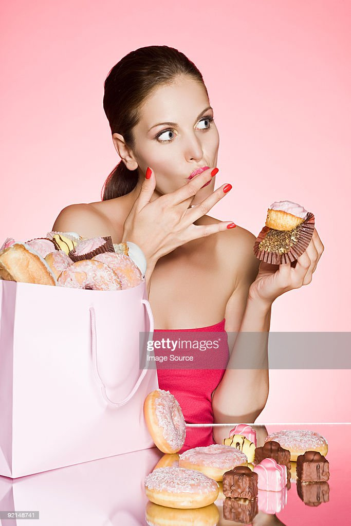Young woman with a cupcake : Stock Photo