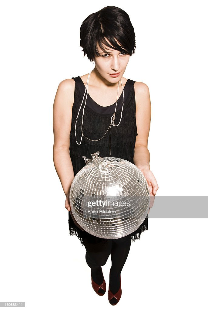 Young woman with a disco ball in her hands : Stock Photo