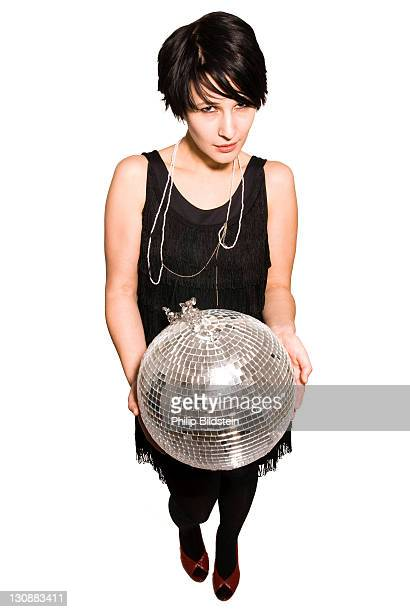 Young woman with a disco ball in her hands